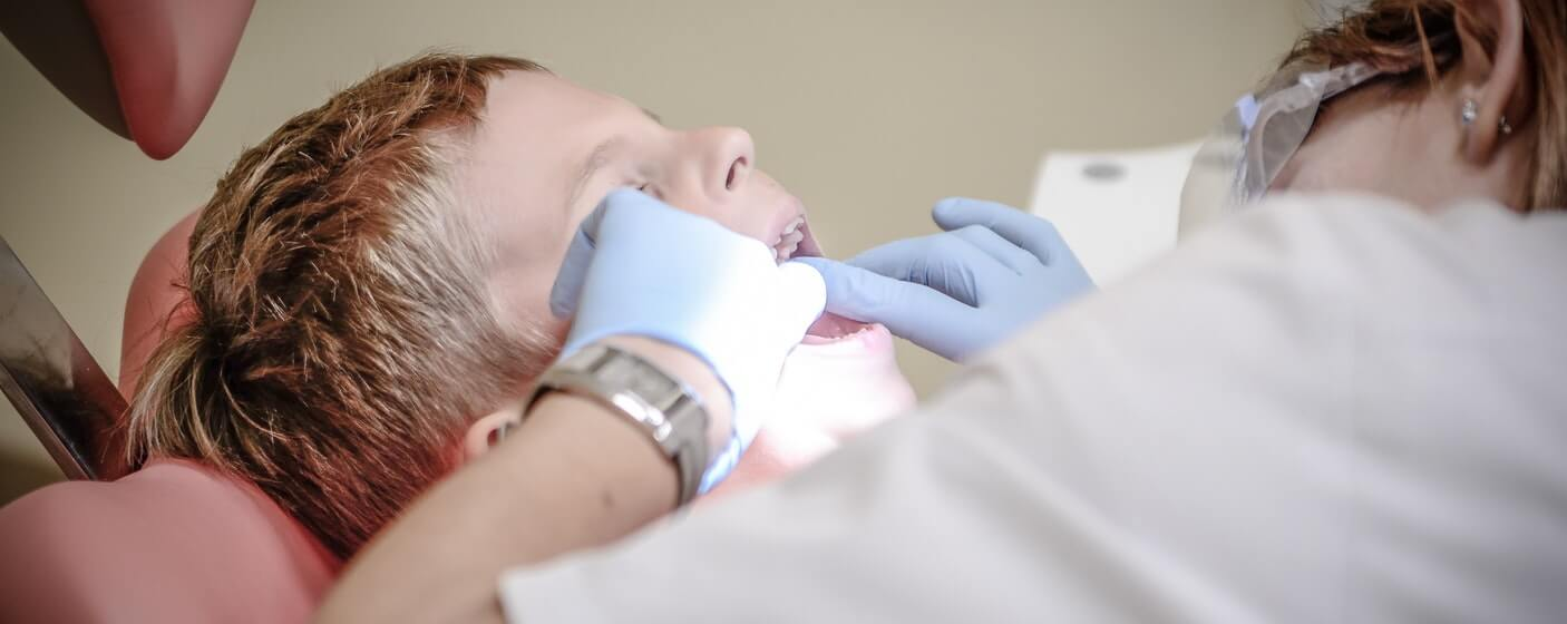 boy getting a check up at the dentist
