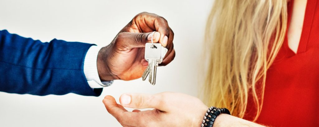 real estate agents handing over keys