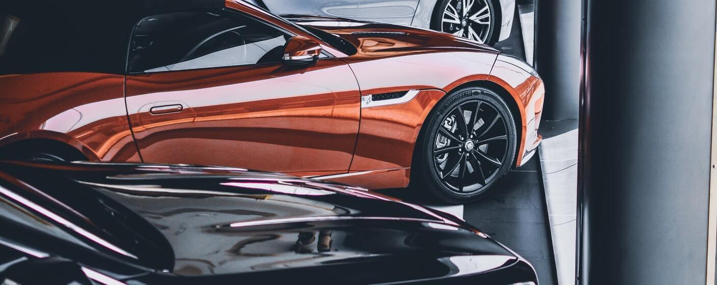 side shot of a orange car